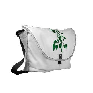 Pimientas verdes en gráfico de la planta verde bolsa messenger