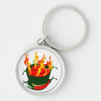 Pimientos picantes en llamas verdes de la taza llavero redondo plateado