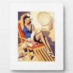 Pin del marinero de la silla de cubierta encima de placas con fotos