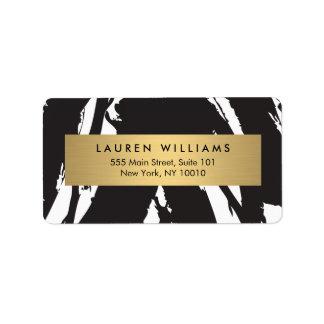 Pinceladas negras abstractas con la etiqueta del etiqueta de dirección