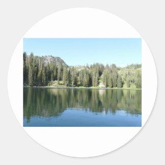 pine tree mirror on lake round stickers