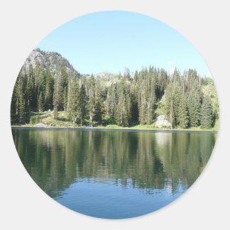 pine tree mirror on lake round sticker