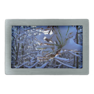 Pine tree with snow and light reflecting on a need rectangular belt buckle
