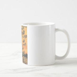 Pine Trees Against a Red Sky Coffee Mug