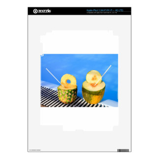 Pineapple and melon fruit with straws at pool skin for iPad 3