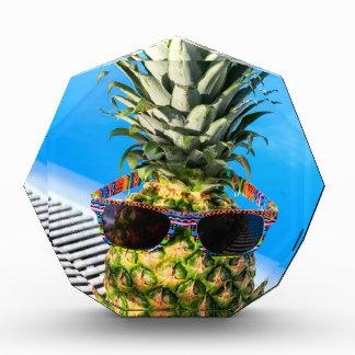 Pineapple wearing sunglasses at swimming pool award