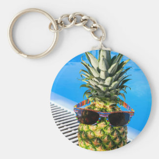 Pineapple wearing sunglasses at swimming pool keychain