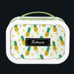 """Pineapples pattern lunch box<br><div class=""""desc"""">This product has a pattern design of pineapples with slices. It is a cool summer design. You can personalize it by putting your name on it using the template and also you can change the background color from white to any other. This fun summer design is suitable for all.</div>"""
