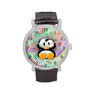 Pingüino adorable del dibujo animado que se sienta relojes