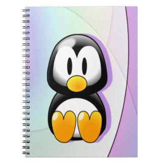 Pingüino adorable del dibujo animado que se sienta spiral notebooks