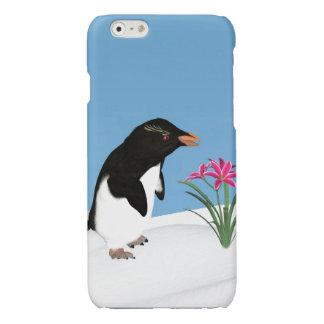 Pingüino chistoso y flores rosadas