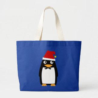 Pingüino con el bolso del gorra de Santa Bolsa