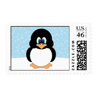 Pingüino con franqueo de los copos de nieve