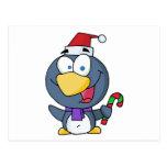 Pingüino de Santa con el bastón de caramelo Tarjetas Postales