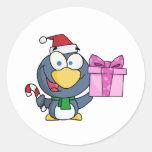 Pingüino de Santa con el navidad regalo y el bastó Pegatina