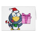 Pingüino de Santa con el navidad regalo y el bastó Tarjeton