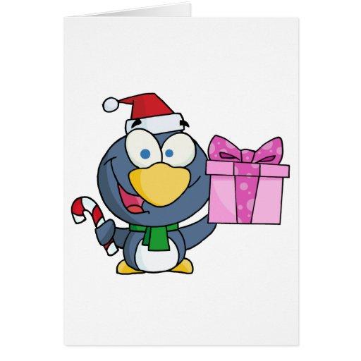 Pingüino de Santa con el navidad regalo y el bastó Tarjeta De Felicitación