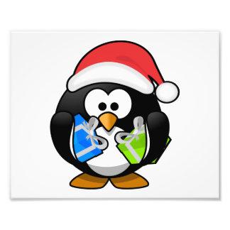Pingüino de Santa con los presentes Fotos