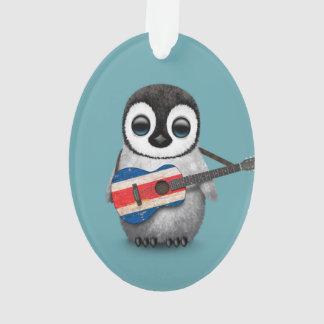 Pingüino del bebé que juega el azul de la guitarra