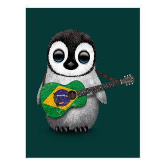 Pingüino del bebé que juega el trullo brasileño de postal