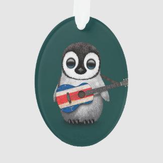 Pingüino del bebé que juega el trullo de la