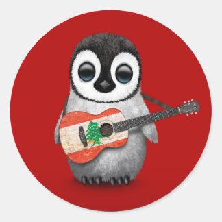 Pingüino del bebé que juega rojo libanés de la pegatina redonda
