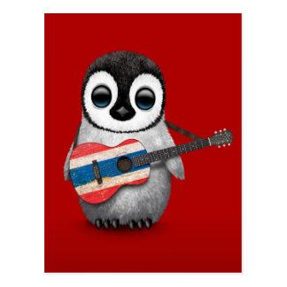 Pingüino del bebé que juega rojo tailandés de la postal