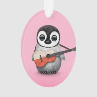 Pingüino del bebé que juega rosa polaco de la