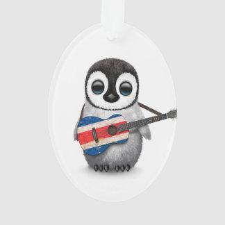 Pingüino del bebé que toca la guitarra de la