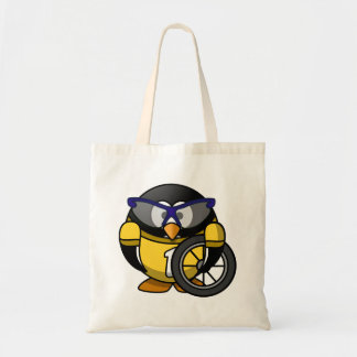 Pingüino del ciclista en amarillo bolsas lienzo
