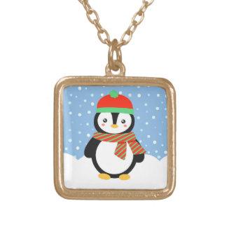 Pingüino del día de fiesta collar dorado