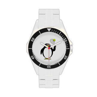 Pingüino del dibujo animado que juega a tenis reloj