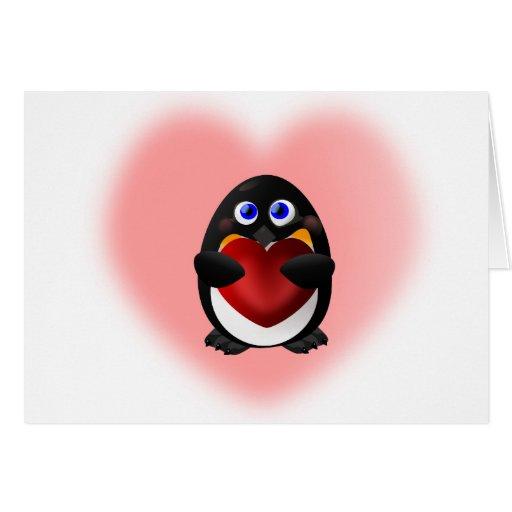 Pingüino del el día de San Valentín con el corazón Tarjetón