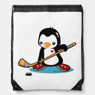 Pingüino del hockey sobre hielo mochila