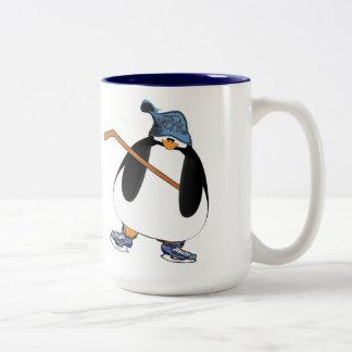 Pingüino del hockey taza