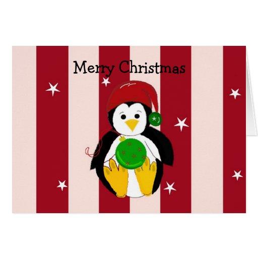 Pingüino del navidad con las barras y estrellas tarjeta de felicitación