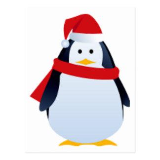 Pingüino del navidad en un gorra de Santa Postal