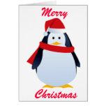 Pingüino del navidad en un gorra de Santa Tarjetón