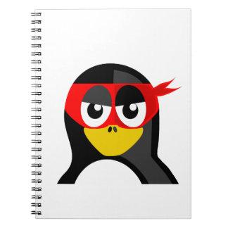 Pingüino del super héroe libreta