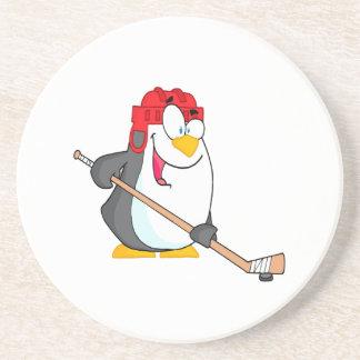 pingüino divertido que juega el dibujo animado del posavasos de arenisca