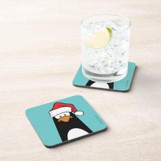 Pingüino en un práctico de costa del corcho del go posavasos de bebida