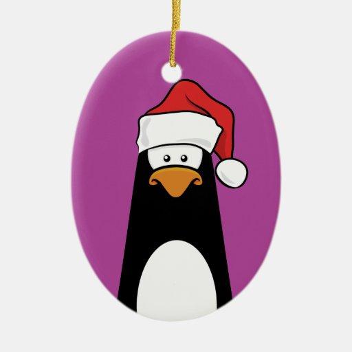 Pingüino festivo en un gorra de Santa (rosa) Adorno Navideño Ovalado De Cerámica