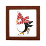 Pingüino lindo con la caja de regalo de los patine