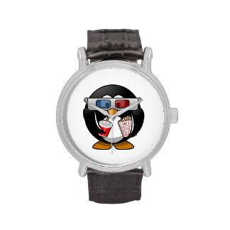 Pingüino lindo del dibujo animado en las películas relojes de mano