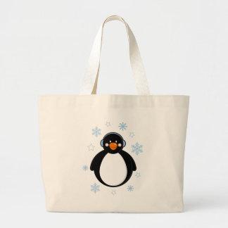 Pingüino lindo del navidad en orejeras bolsa tela grande