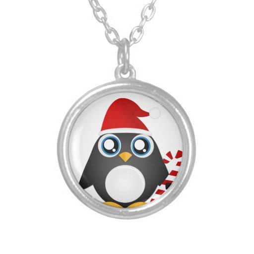 Pingüino lindo del navidad grimpola