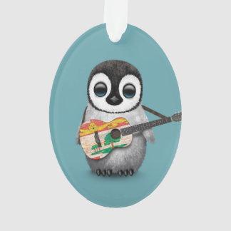 Pingüino lindo que juega el azul de la guitarra de