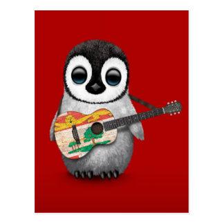 Pingüino lindo que juega rojo de la guitarra de la tarjetas postales