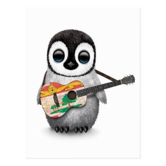 Pingüino lindo que toca la guitarra de la bandera postal