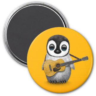 Pingüino musical del bebé que juega amarillo de la imán redondo 7 cm